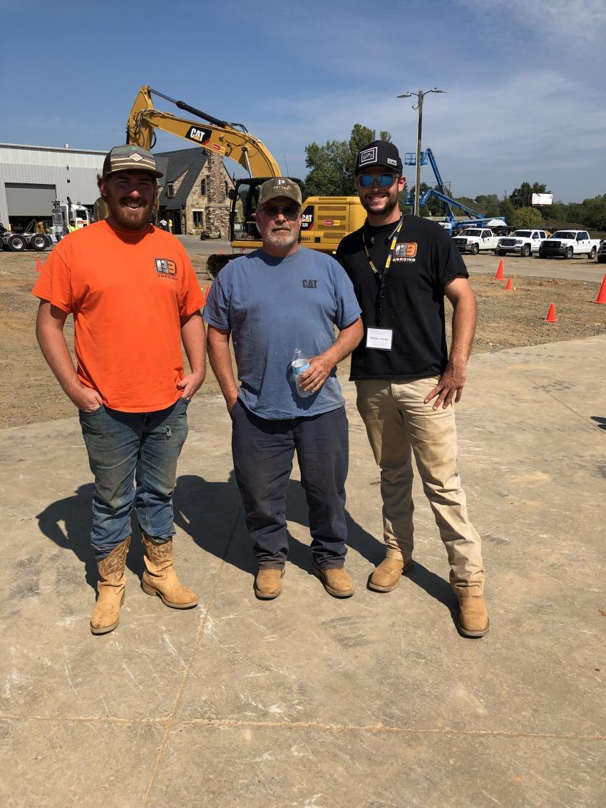 Hayden Connell, Kenny Smith and Austin Hardy, all of P3 Services in Charlotte, wait to test the E-fence feature on the Next Generation Cat 320 excavator. Using the system's E-fence feature enables the machine to work safely under structures or near traffic by preventing any part of the excavator from moving outside operator-defined set points.