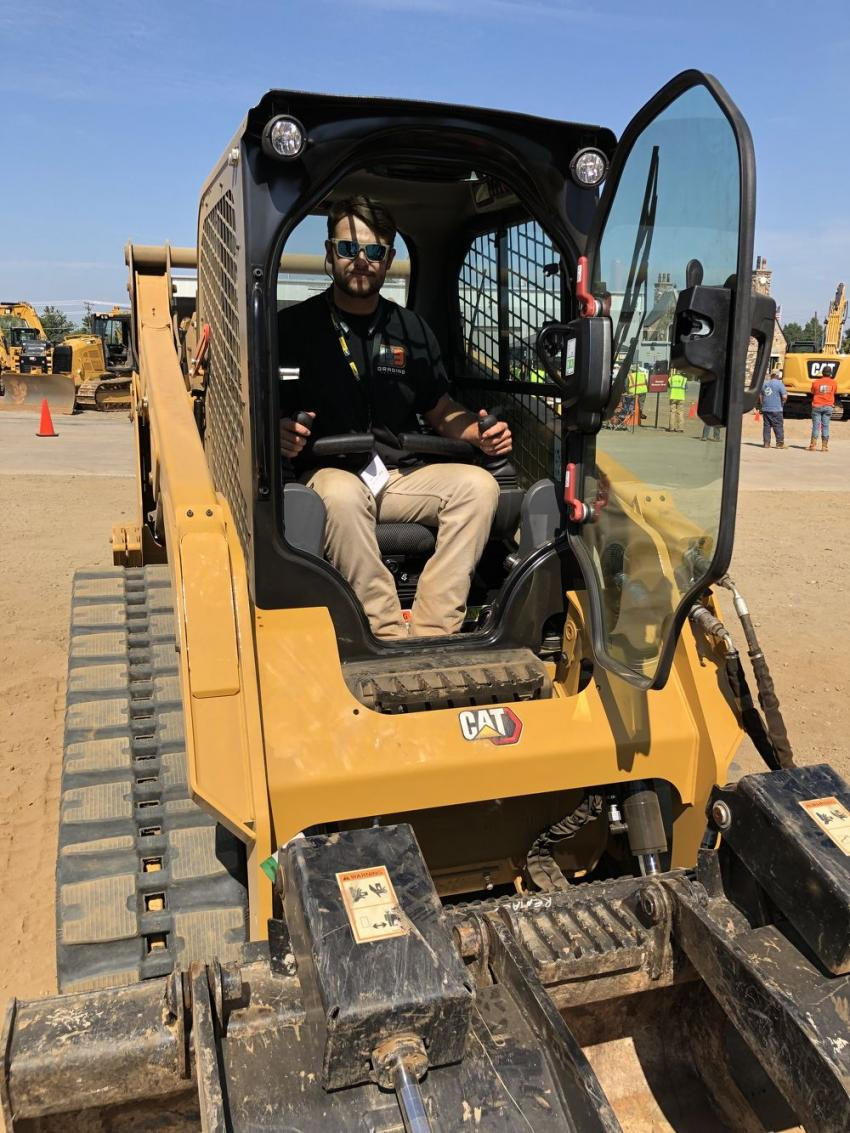 Austin Hardy of P3 Services in Charlotte, N.C., gets the feel of the new Cat 259D3 compact track loader, prior to starting the obstacle course.