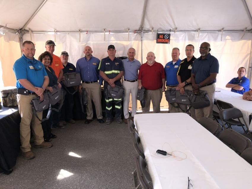 The original employees of the Mebane, N.C., branch gather with Greg Poole (C); they were each given a portable cooler as a way to say thanks.