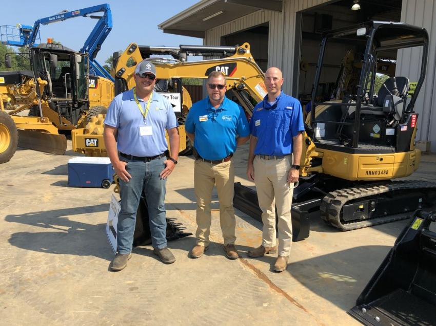 (L-R): Rob Long of Charah Solutions in Roxboro, N.C., with Marshall Bryant and Rob Jackson, both of Gregory Poole Equipment Company.