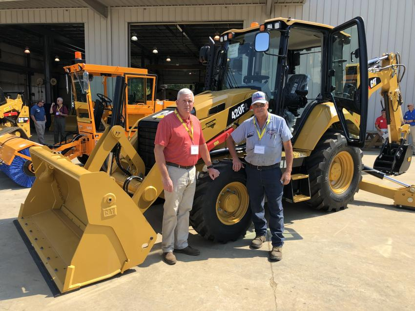 Jeff Hinkle (L) of Gregory Poole Equipment Company goes over the new Cat 420F Series 2 backhoe with Kenneth Roney of Chandler Concrete in Burlington, N.C.