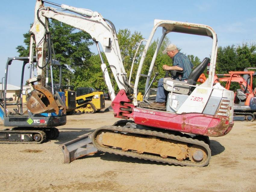 Test operating a Takeuchi TB235 mini-excavator for some work to be done on his farm is Lamar Huff.