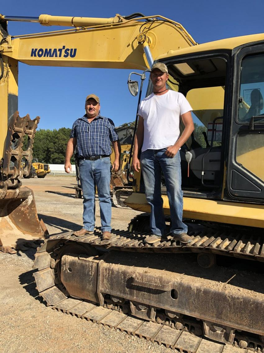 Miguel Espinoza (L) and Quentin Deal, both of Deal Company in Lake Wylie, S.C., came to the auction to buy an excavator and maybe a dozer.