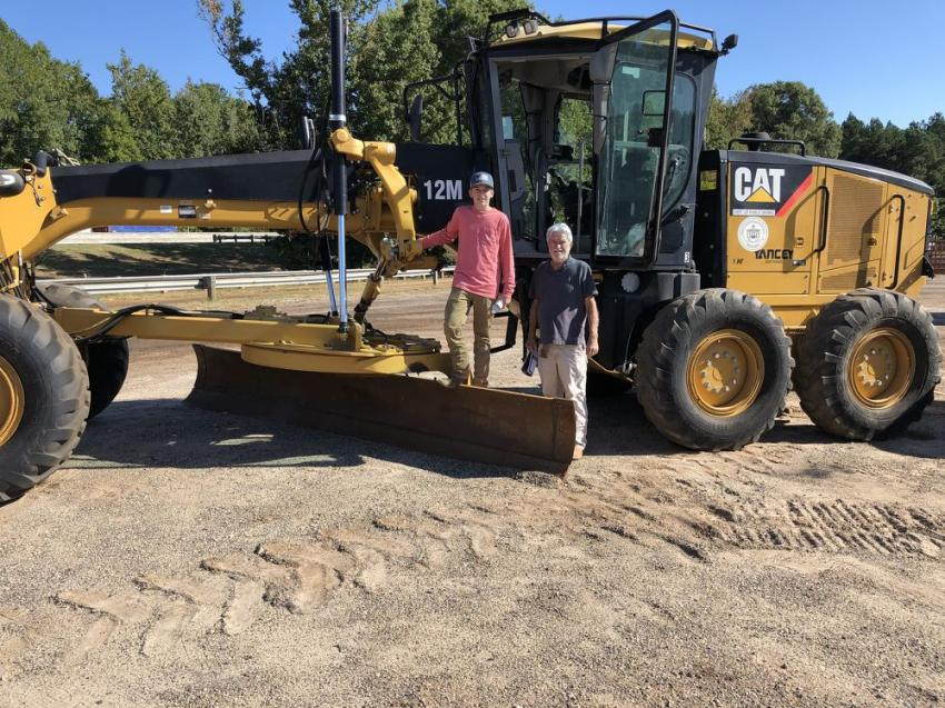 Lex Pryer (L) and Roy Raines, both of R&R Equipment in Belton, S.C., came to the auction to bid on and hopefully buy this Cat 12M motorgrader.