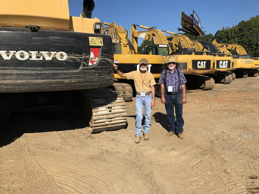 Mike Longshore (L) and Joe Golden, both of Longshore Land Clearing in Kinards, S.C., looked over the wide selection of excavators and planned to bid on this Volvo machine.