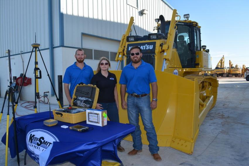 On hand to answer questions about the Komatsu D65exi with Intelligent Machine Control (L-R) were  Isaac Lawrence, smart construction specialist; Rebecca McNatt, director of construction technology; and Eddie Garcia, smart construction specialist.