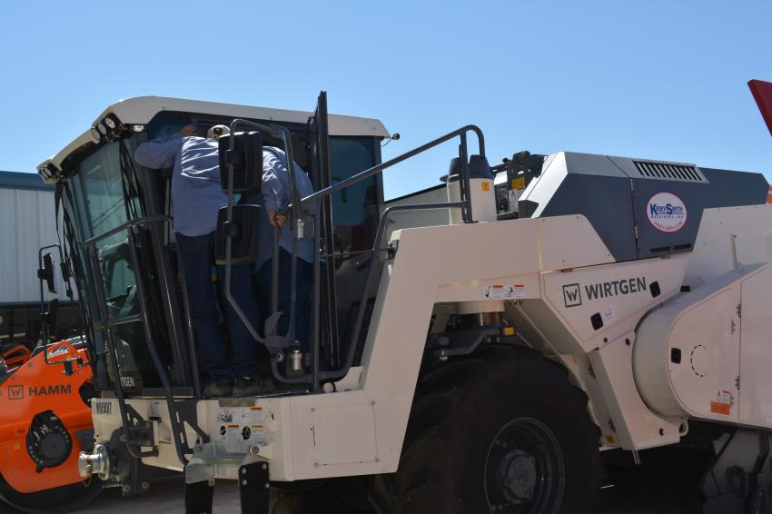 Officials from county highway departments crowd in for a look at the cab of the Wirtgen WR 200xli, a cold recycler and soil stabilizer.  Kirby-Smith represents the Wirtgen line of machines at nine of its branches in Texas and Oklahoma.
