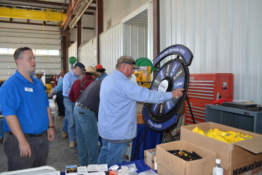 Rip Pothoff of the city of Midland takes his turn spinning for a variety of door prizes during the Kirby-Smith open house in Odessa.