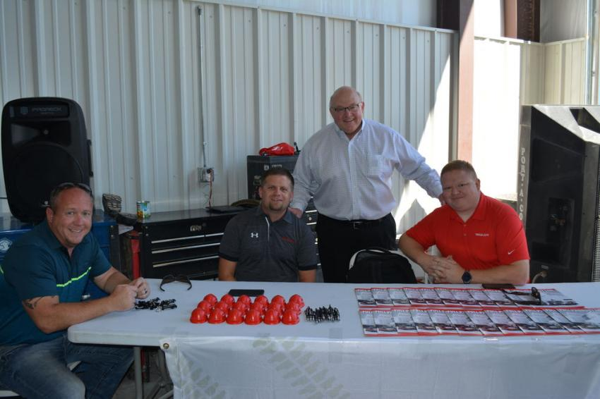 Del Keffer (standing), vice president of sales, Kirby-Smith, dropped by the Takeuchi booth to talk with (L-R) JP Cotton, Kirby-Smith's West Texas finance manager, and Sam Schneider and Shay Klusmeyer, both of Takeuchi.
