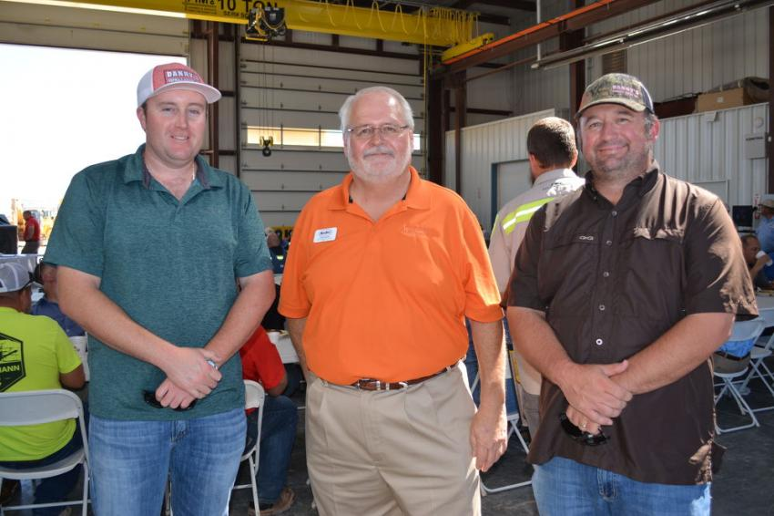 Randy Bailey (C), branch manager of Kirby-Smith Odessa, is flanked by Joe Carroll (L) and GW Hanson, both of Danny's Asphalt Paving, Odessa, Texas.