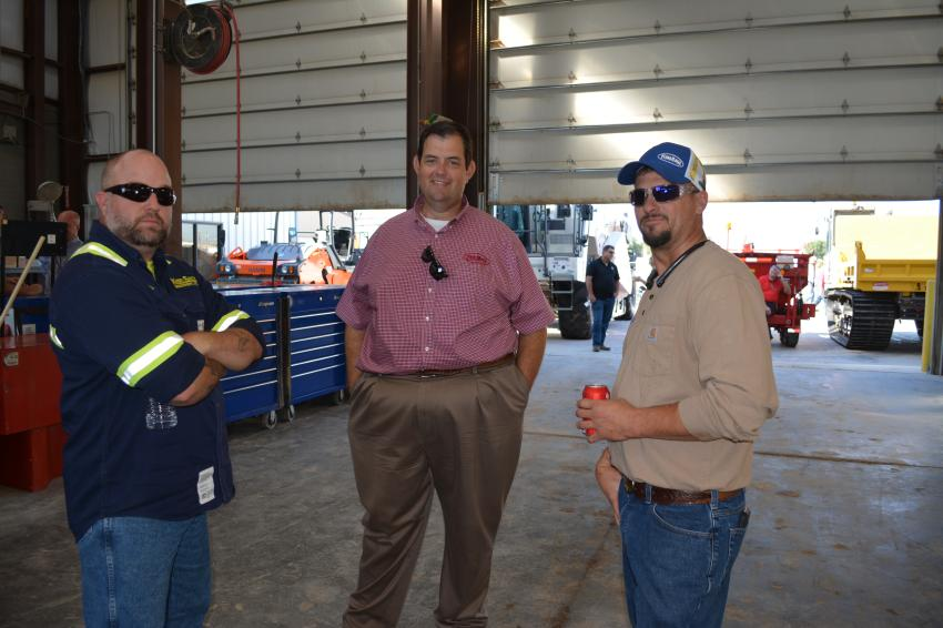 Kirby-Smith employees talk cranes at the Odessa branch open house. (L-R): Fhykis Robert, field technician; Chip Leatherwood, crane product support manager; and Tyler Grant, field technician.