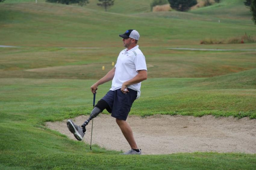 Chris Roseberry, facilities manager of the Travis Mills Foundation, watched to see where his ball would land.