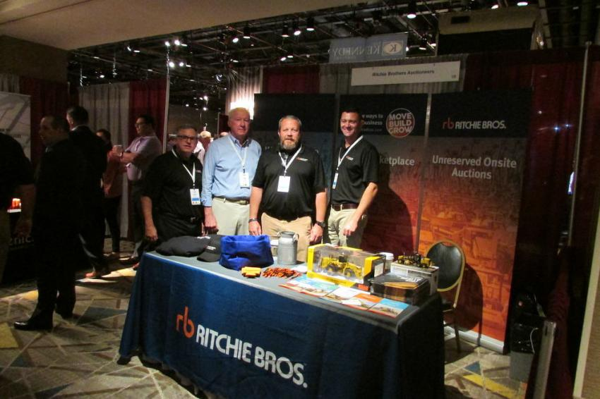 At the Ritchie Bros. booth (L-R) are Fred Vilsmeier, Ritchie Bros.; Tom Carton, The Mahan Group; and Scott Smith and Adam Byrne, both of Ritchie Bros.