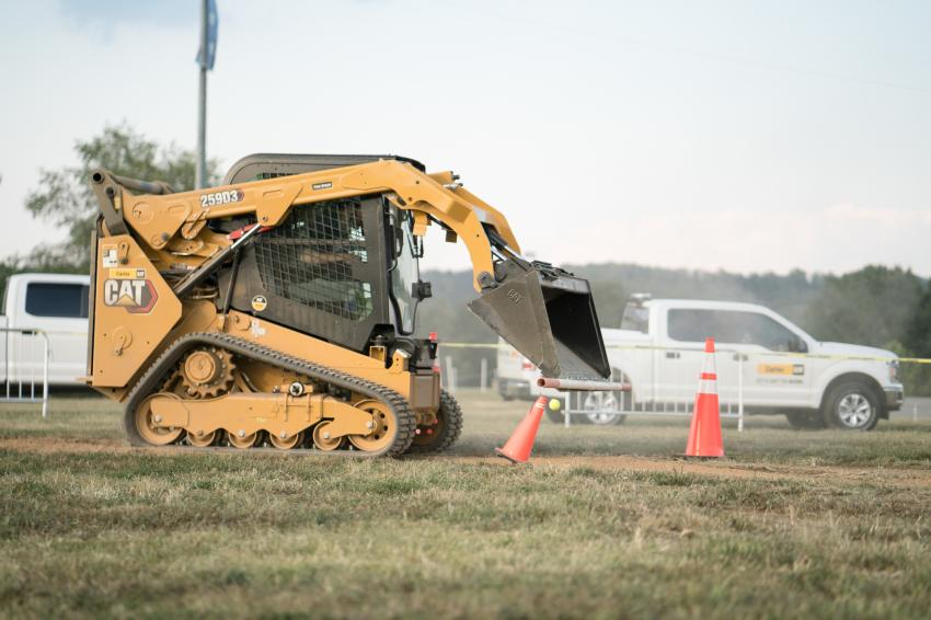 The compact track loader course, which included knocking tennis balls off cones and navigating through a figure-eight course, was the most popular.