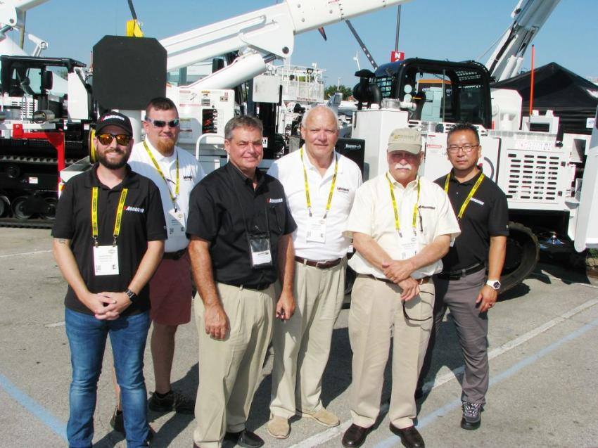 Displaying their newest product offerings and new larger sized and more diverse configurations of Morooka utilities carriers, including a Morooka MST4500VDL carrier with a 40-ton crane, (L-R) are David Byrd, Jason Sage, Curt Unger, John Lide, Buck Seymour and Hide Takaya.