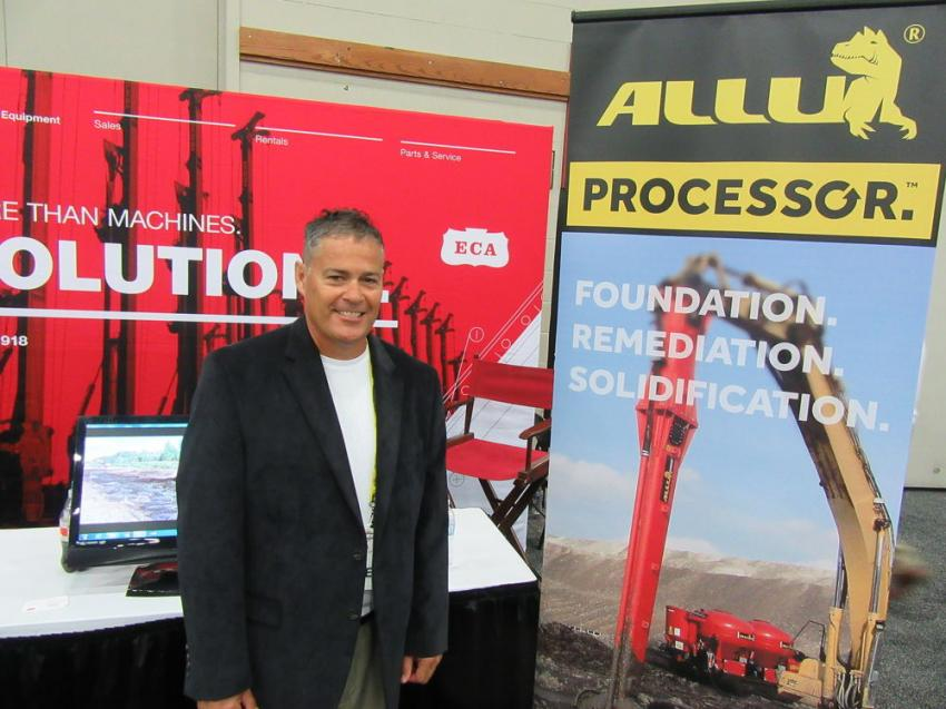 Equipment Corporation of America's Tom Wardell speaks with attendees about the company's foundation and soil remediation equipment, including the ALLU Processor, an excavator attachment capable of penetrating and effectively mixing a variety of difficult materials.