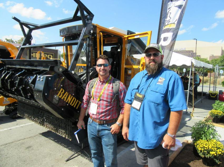 Jason Hardage (L) of GGB, based in Thorofare, N.J. discusses the latest equipment innovations from Bandit Industries with Scott Woods.