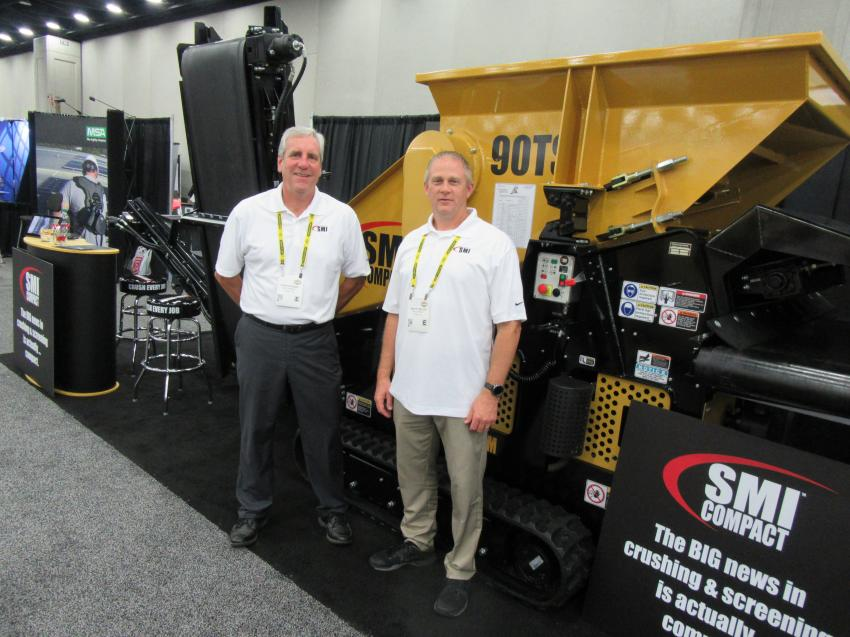 Dave Stewart (L) and Tim Miller, of SMI Compact, a division of Screen Machine Industries, discuss the company's line of compact crusher and screeners sized to address a wide variety of jobsite applications.