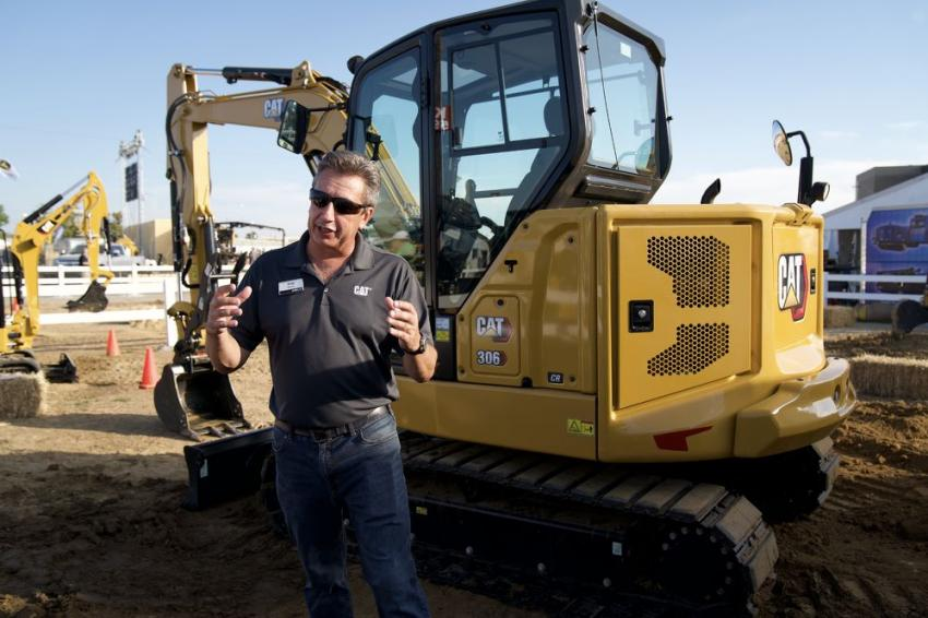 Greg Worley, product specialist of Caterpillar, shows off the new 6-ton class Cat 306 CR Next Generation mini-hydraulic excavator.