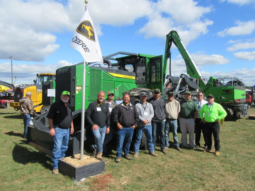 A full contingent of Murphy Tractor representatives were on hand to discuss John Deere equipment. (L-R) are Murphy Tractor's Gary Shugart, Brian Mayfield, Danny Catrell, Eric Bischoff, Justin Flowers, Derrick Smith, Pete Brown, John Deere Forestry Product Consultant Carl Lockhart, along with Murphy Tractor's Marty Hlawati, and R. Dennis O'Loughlin.
