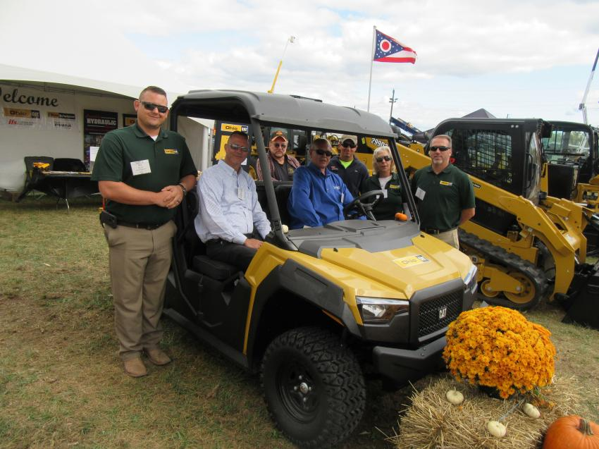 (L-R, front): Ohio Cat's Rob Lowry, Art Westfall, Rich Egnot, Linda Meier and Brian Speelman were joined by (L-R, back) Jeff Watkins of Watkins Excavating and Zeb Kitzler of Vaughn Industries to review the equipment on display at the show.