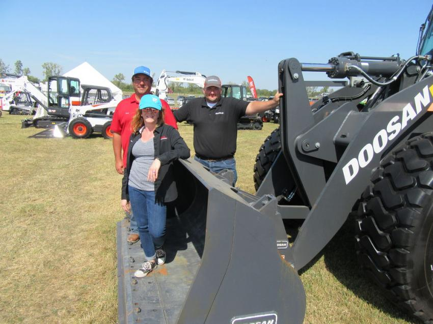 At the Bobcat Enterprises equipment display, Heather Murray, David Sarrey (L) and Ryan Davis were ready to discuss the dealership's lineup of Bobcat and Doosan equipment.