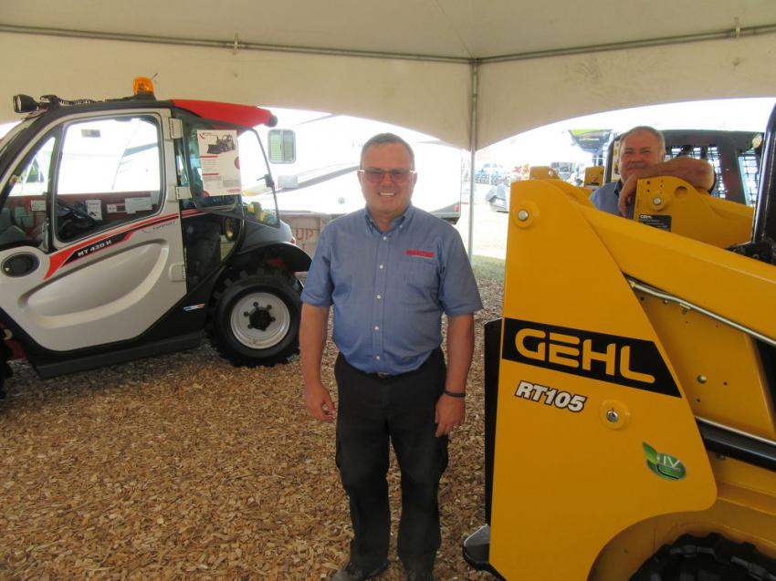 At the Manitou equipment display, P.L. (Lou) D'Alesio (L) and John Rau presented the recently-introduced Gehl RT105 track loader and Mustang 1050RT track loader.