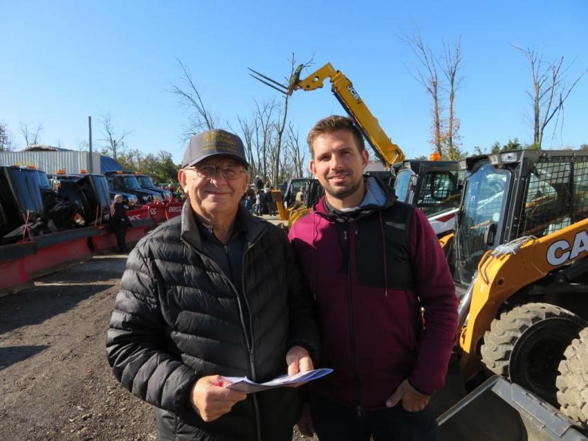 Ted Bart (L) and his son, Chris, owners of Bart Industries, came to see if they could take a few of the skid steers home with them.