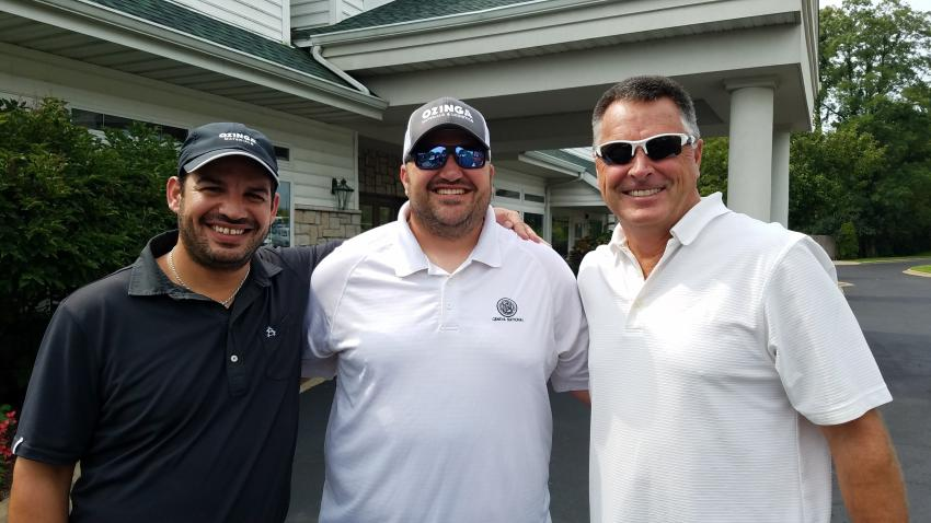 Ozinga Materials players are ready for a round of golf. (L-R) are Aaron Ozinga, Vince Caputo and Bill Pavan.