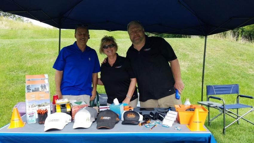 (L-R): Mike Boyda of Vulcan Materials welcomed Debbie Gallagher and Scott Harper, both of Ritchie Bros.