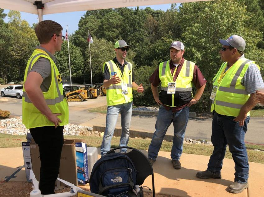 (L-R): Matt McCullough and Cameron Bentley, both of Sitech Mid Atlantic, go through the benefits of Trimble machine control systems with Barry Suggs and Bobby Friar, both of Palmetto Corp. in Conway, S.C.