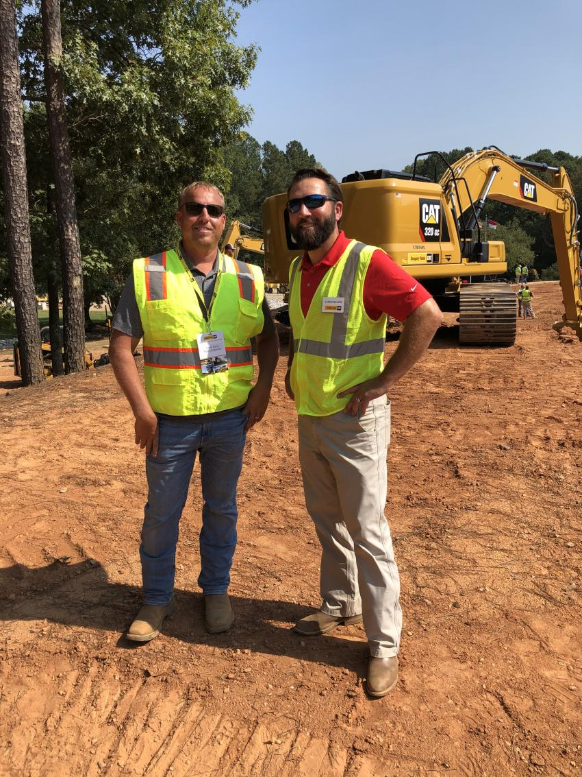 Chris Ford (L) of Ford Companies in Clayton, N.C., gets an overview of the Cat Next Generation excavators from Jared Bauer of Gregory Poole Equipment Company.