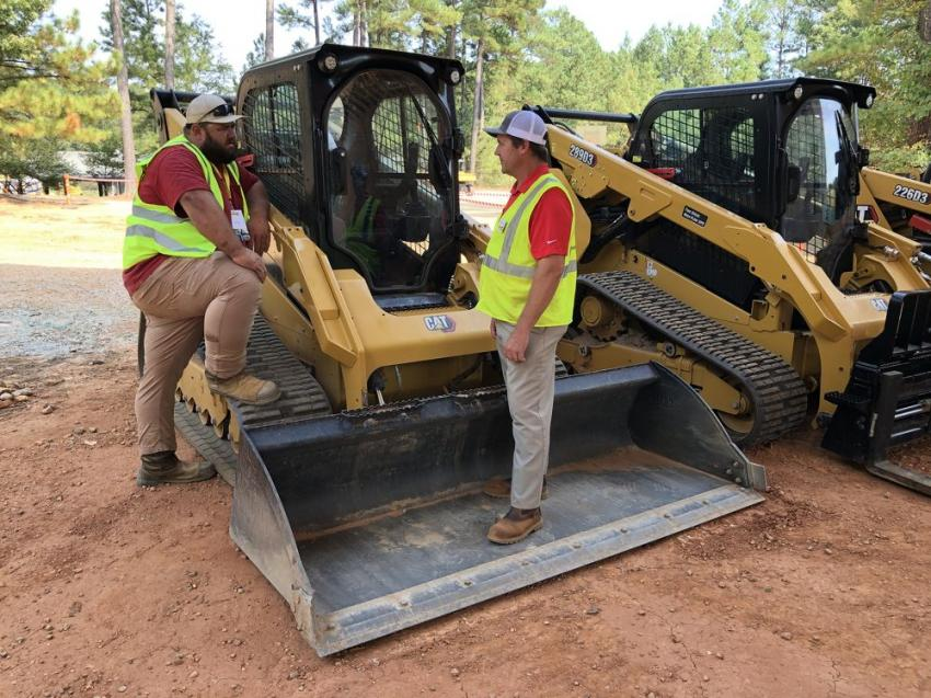 John Ennis (L) of Ennis Services in Holly Springs, N.C., gets an update on the Next Generation Cat 299D3 compact track loader.