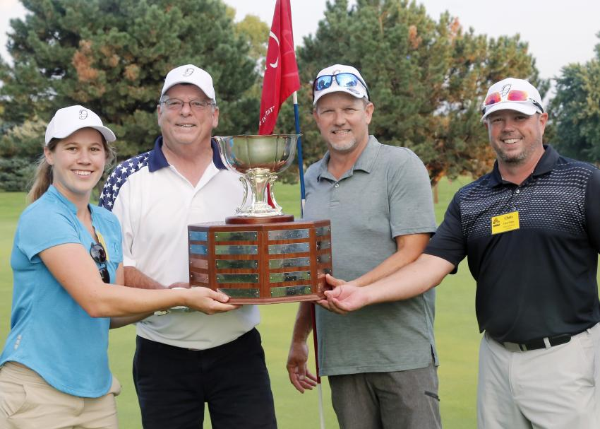 "GOMACO Invitational #38 ""Grand"" Champions were from the Holstein golf course and included team members (L-R) Brittany Diederich of Industrial Builders; Dave Clark of Wicks Construction; Clayton Shively of Berry Tractor and Equipment Co.; and Chris Wilsey of TAB Construction Company."