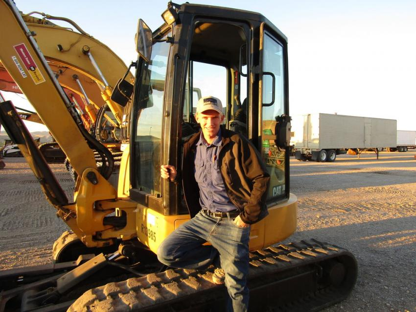 Lance Barlow examines this 2016 Caterpillar midi-excavator for possible use for fence building and digging trenches on his family's cattle ranch in Cedar City, Utah.