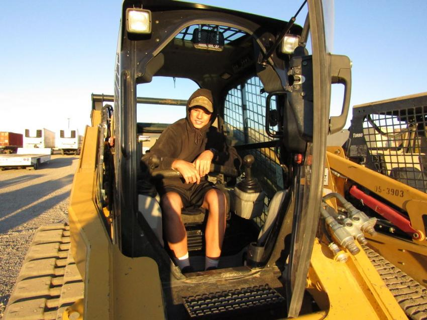 Clark Rowley enjoyed his day off from school by helping his dad test out this 2013 Caterpillar compact track loader for their business, One Stop Hydraulic Shop, St. George, Utah.
