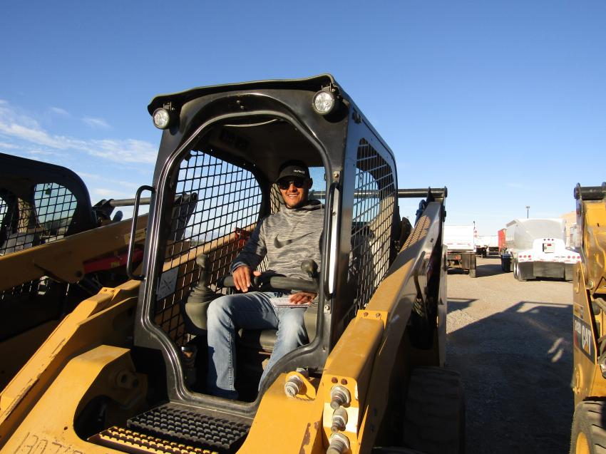 World's Demolition's, Ivan Gaytan, based in Southern California, gets behind the wheel of this 2013 Caterpillar skid steer loader. While Ivan sometime dabbles in the online bidding at Ritchie Bros., he still prefers the benefit of trying out the machines firsthand.