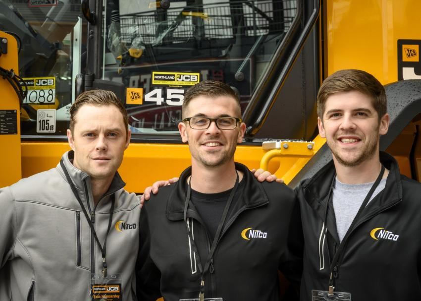 (L-R): Evan Hammersley of Nitco, and Alex and Logan Calvey, both of JCB, in front of a JCB 457 wheel loader.