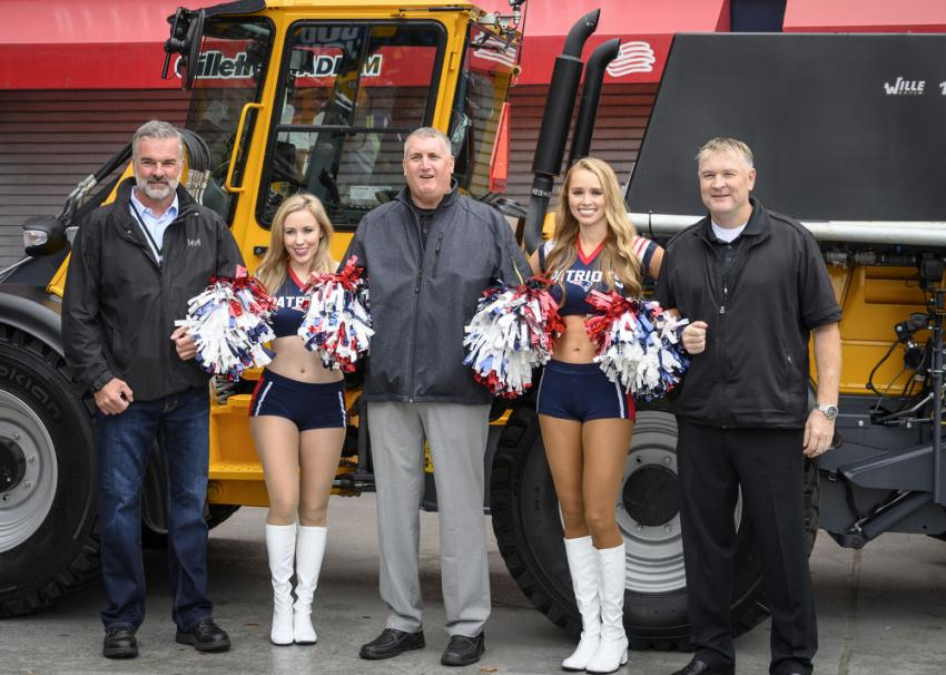 New England Patriot's cheerleaders Ashley B. and Morgan D. with the Wille team. The ladies took to the stadium to greet and take photos with vendors and guests.