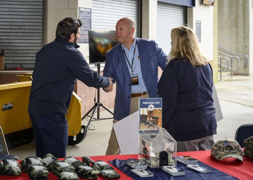 Alan Hammersley, CEO and president of Nitco, meets with Julie Flynn and Justin Sylvia of Homes for the Troops.