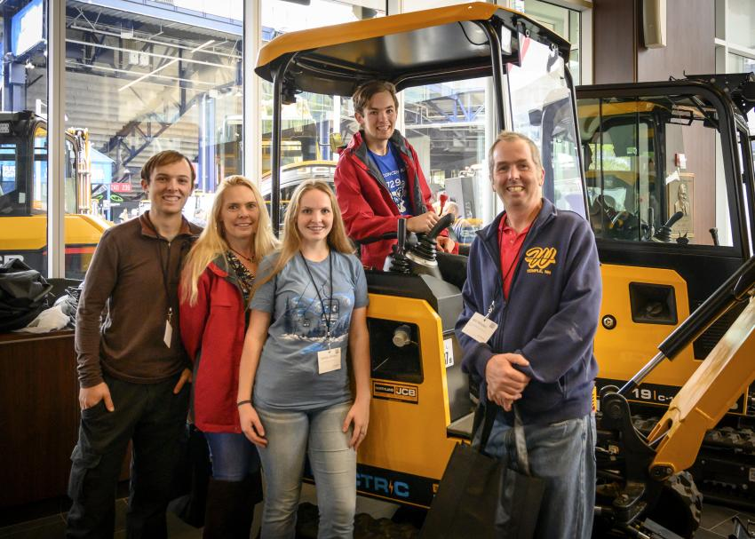 The Wildes family from New Hampshire checks out some of the new JCB equipment line. (L-R): Roland, Sandra, Sydney, Cedrick and Will.
