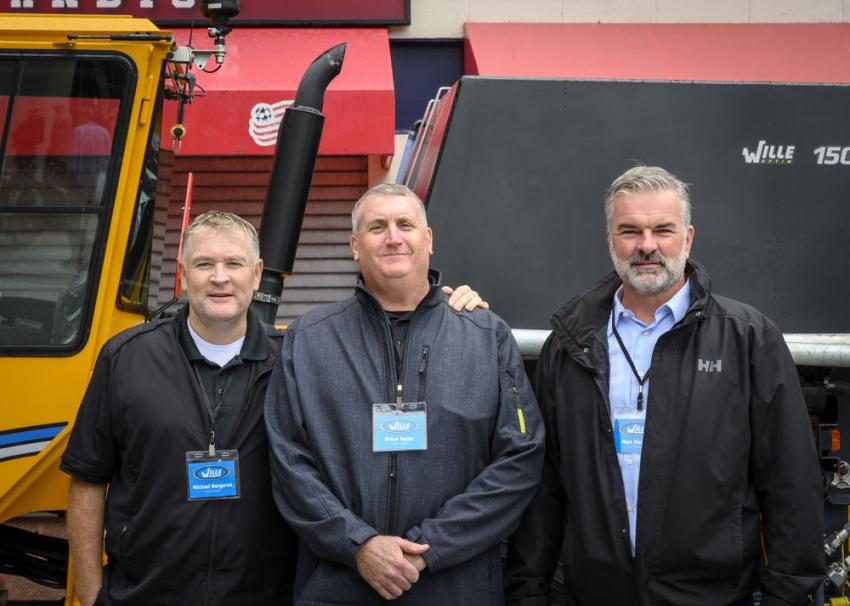 First time event vendor representatives for Wille. (L-R): Michael Bergeron, Bruce Taylor and Marc Fischer in front of their 855c, a multi- tool carrier.