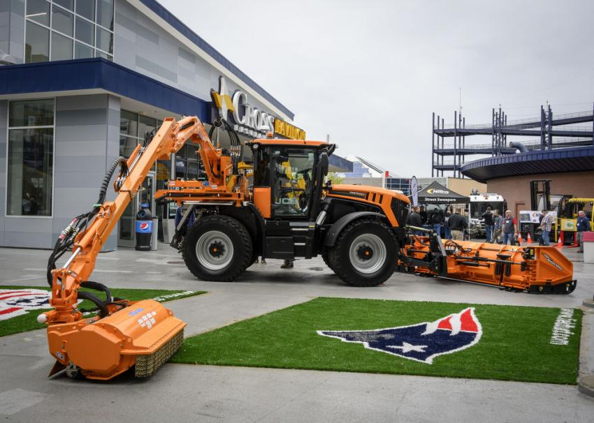 The JCB 4220 versatile tractor with 4203W SnowWing plow and Mulag mower on display at the entrance of the Cross Pavillion.