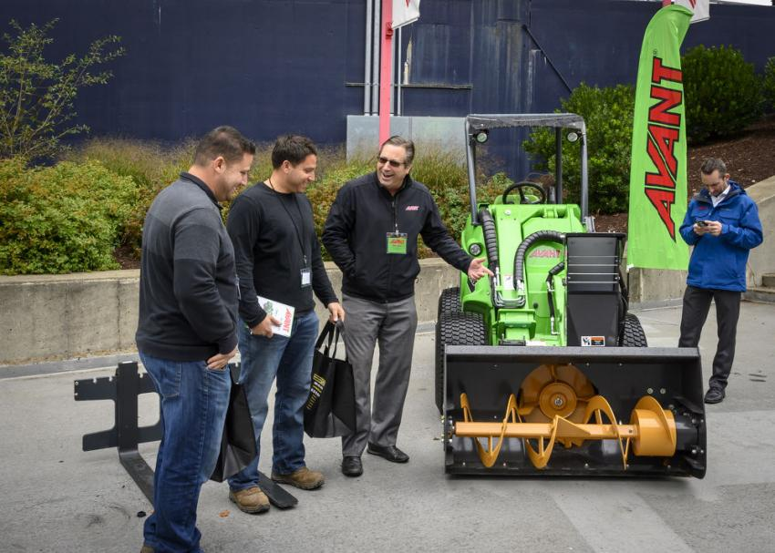 Matt Jarck, director of business development and national accounts of Avant talks about Avant's 528 compact loader with Michael and William DeChristofaro of Cranston, R.I.