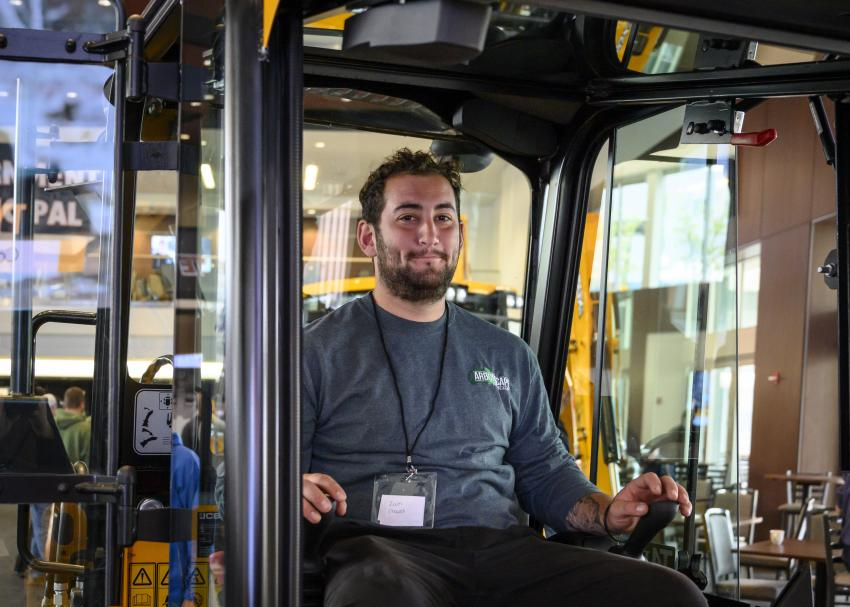 Zack Chaves of Arborscape from Warren, R.I., in the new JCB 1CXT.