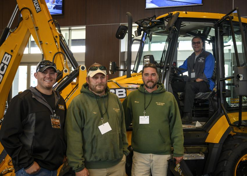 (L-R): Ryan Sears of JCB, Ted Merrow and Marcus John, both of N.H. States Veteran's Cemetery, and Frank Groccia of Batteries Unlimited in Worcester, Mass., check out the cab of the 3CX compact loader.