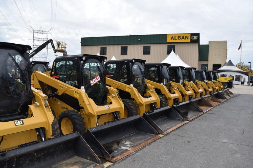 More than 550 items were available to bid on, including this row of skid steers.