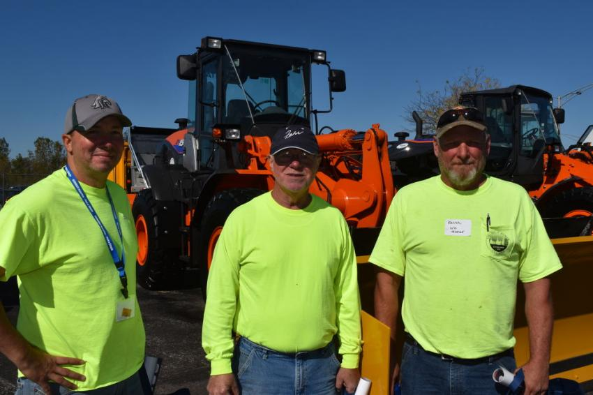 (L-R): With a Hitachi ZW150 are Brian Congdon of the town of Cortlandville, and Buzz Barber and Keith White, both of the village of Homer.