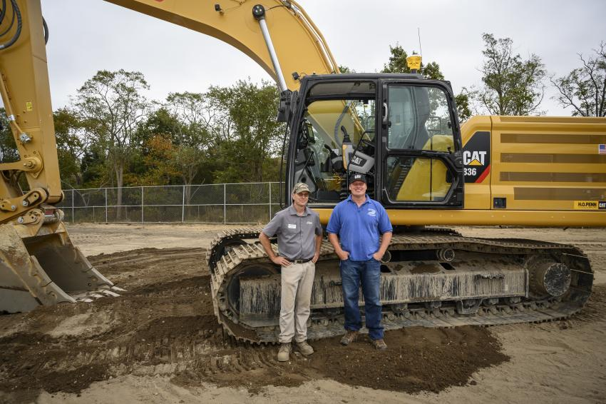 "Jeff Dobosz (L), sales representative of SITECH, and Craig Larsen of Larsen Marine Construction in Wading River, N.Y. ""I come the event every year. I don't normally use a machine this large but you get to run stuff like this. I have been running equipment since I was 10 years old, so I enjoy it. It's always a good time."" Larsen said, after test-driving the Caterpillar 336 hydraulic excavator."