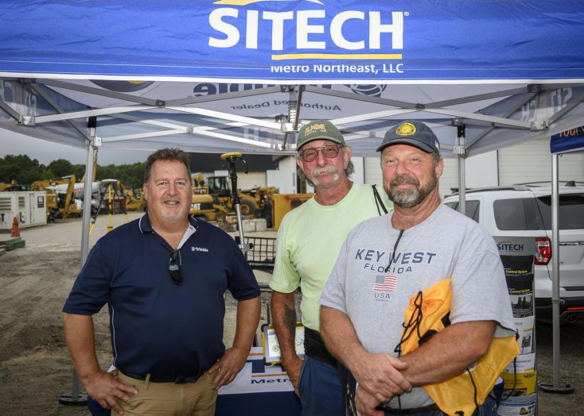 (L-R): Bruce Haynes, regional sales manager of SITECH; and Bob Georgetti and Eric Wold, both of Peter Scalamandre & Sons Inc., Freeport, N.Y., at the SITECH information tent.